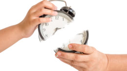 two hands usurp vintage clock. time concept
